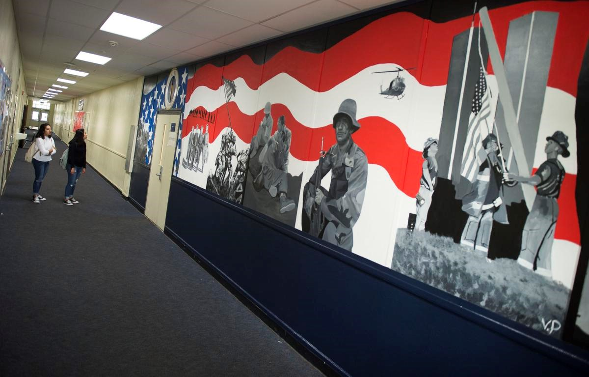 Somos primos santa ana high art students painted a mural for the schools navy junior reserve officer training corp as a tribute to veterans photo by kevin sullivan fandeluxe Images